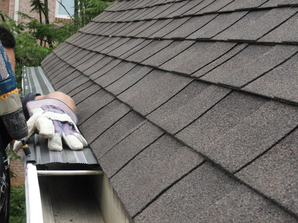 Installing gutter guard with drill